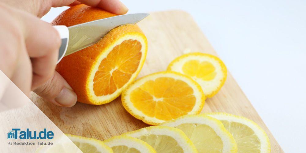 Orange und Zitrone schneiden