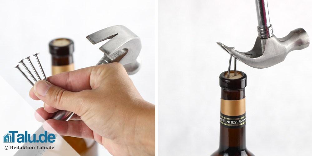 Weinflasche mit Nägeln und Hammer öffnen