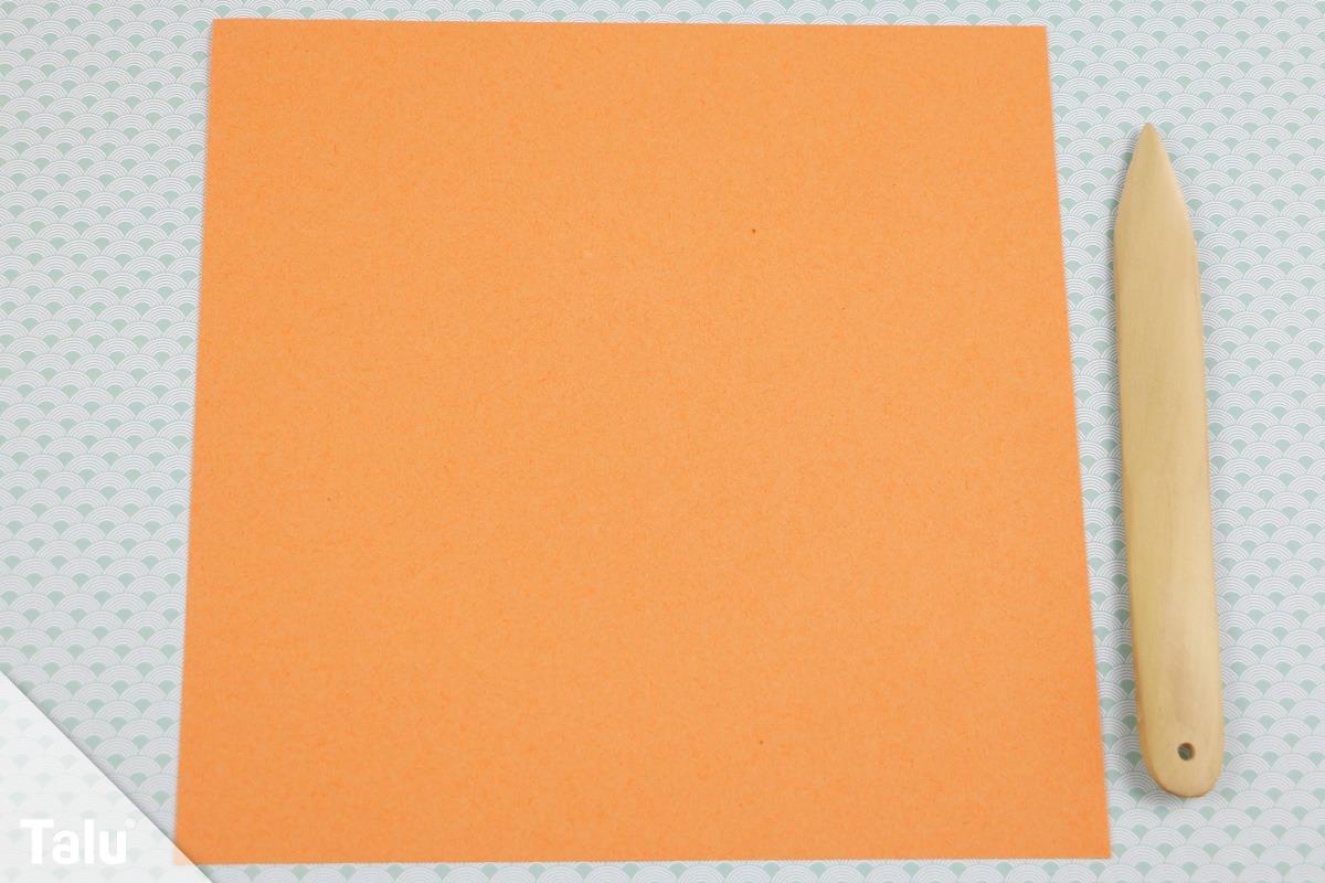 Origamipapier und Falzbein