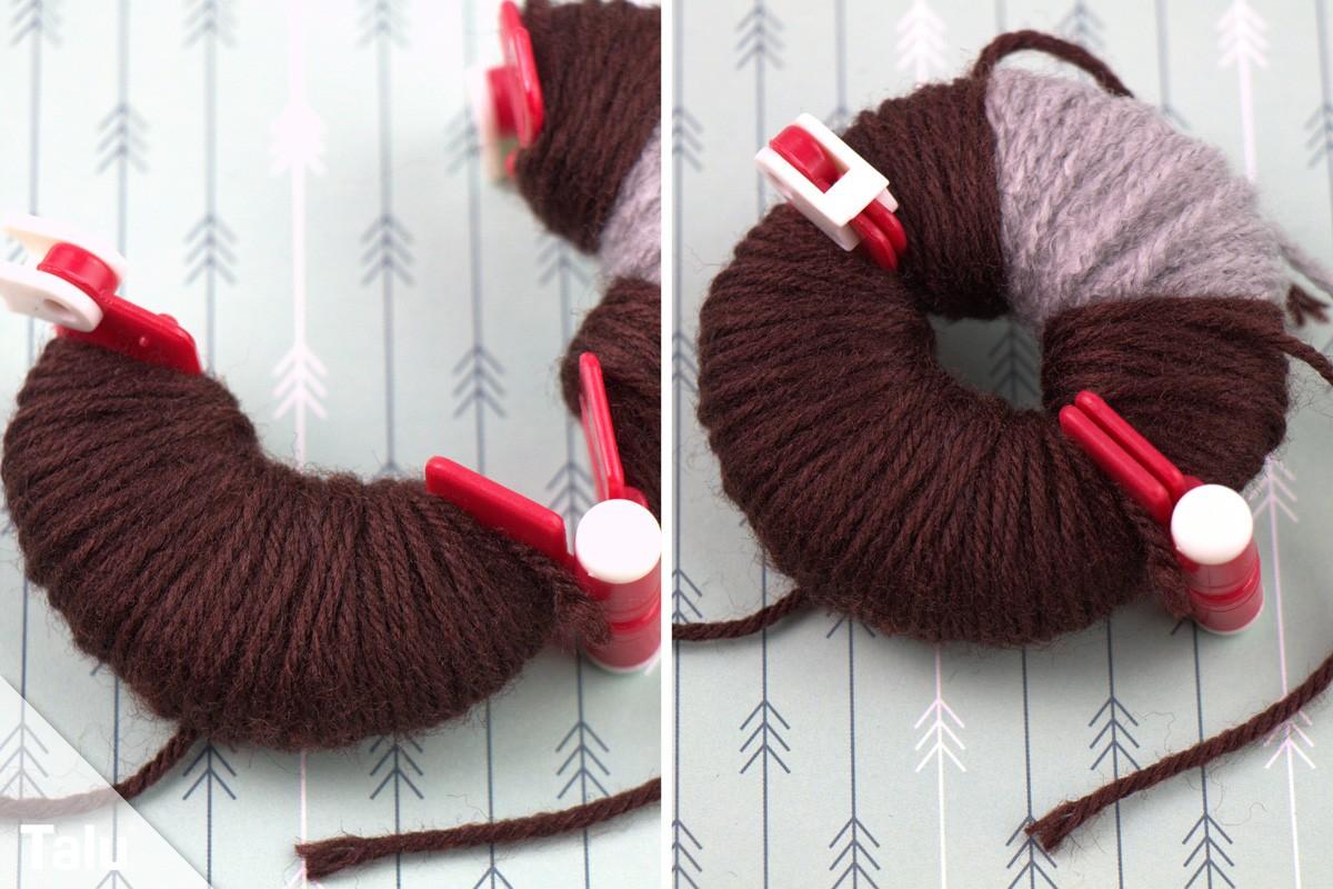 Pompom-Vorlage oder Pompom-Maker mit Wolle umwickeln