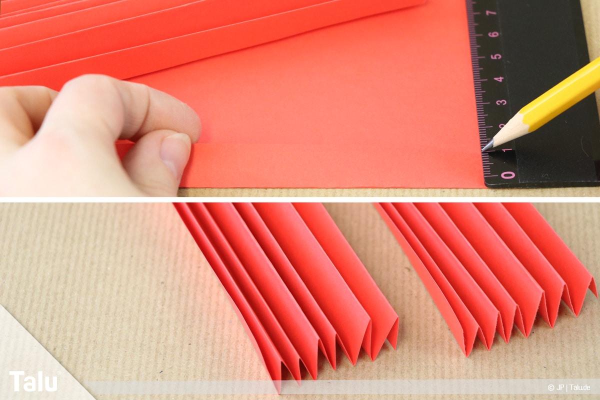 Papierengel basteln, Variante 1, gefaltete, rote Papierfächer
