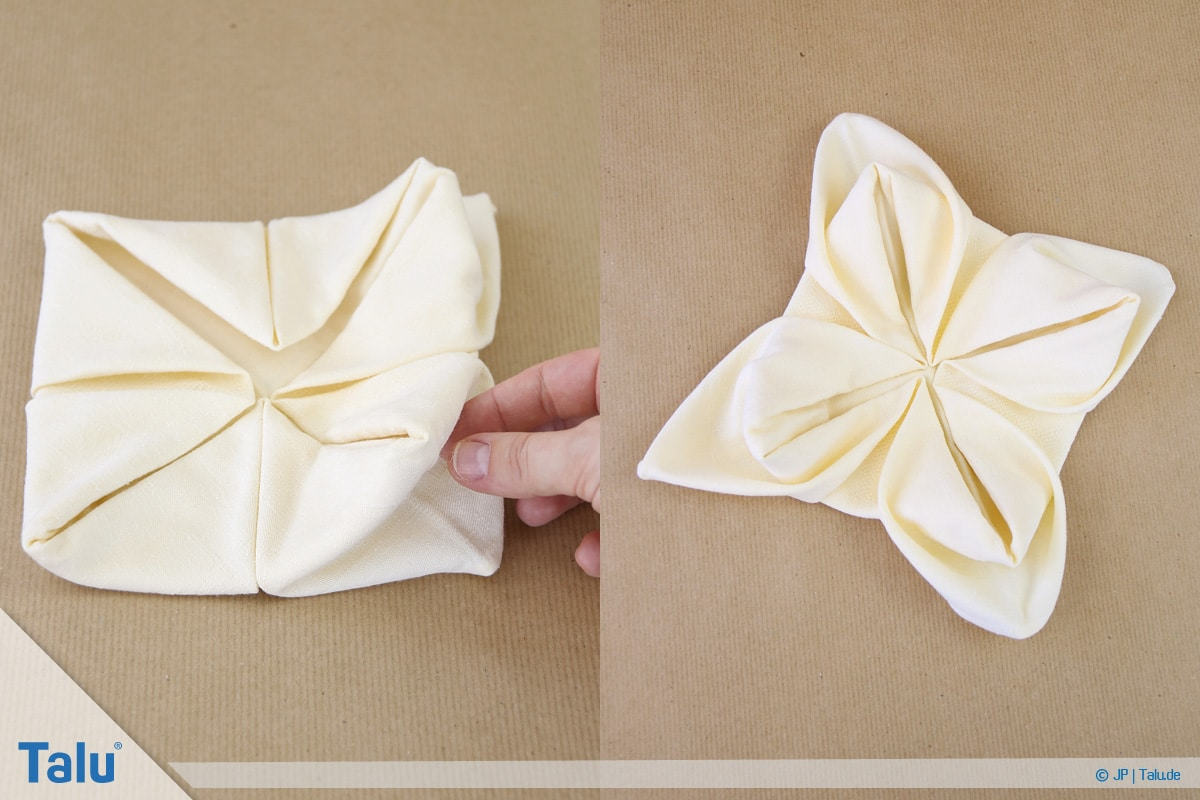 Stoffservietten falten, Seerose fertig gefaltet aus einer Stoffserviette