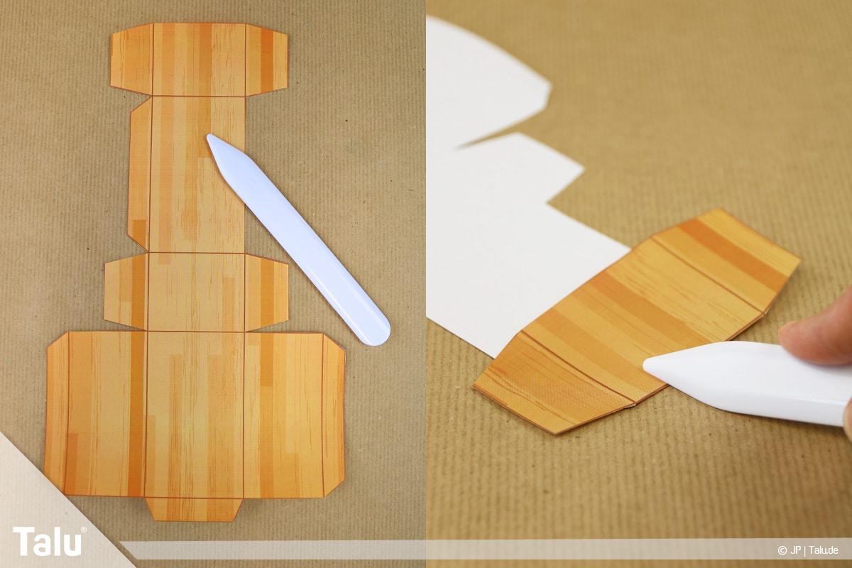 Schatztruhe basteln, Schatzkiste klein, ausgeschnittene Bastelvorlage beginnen zu falten