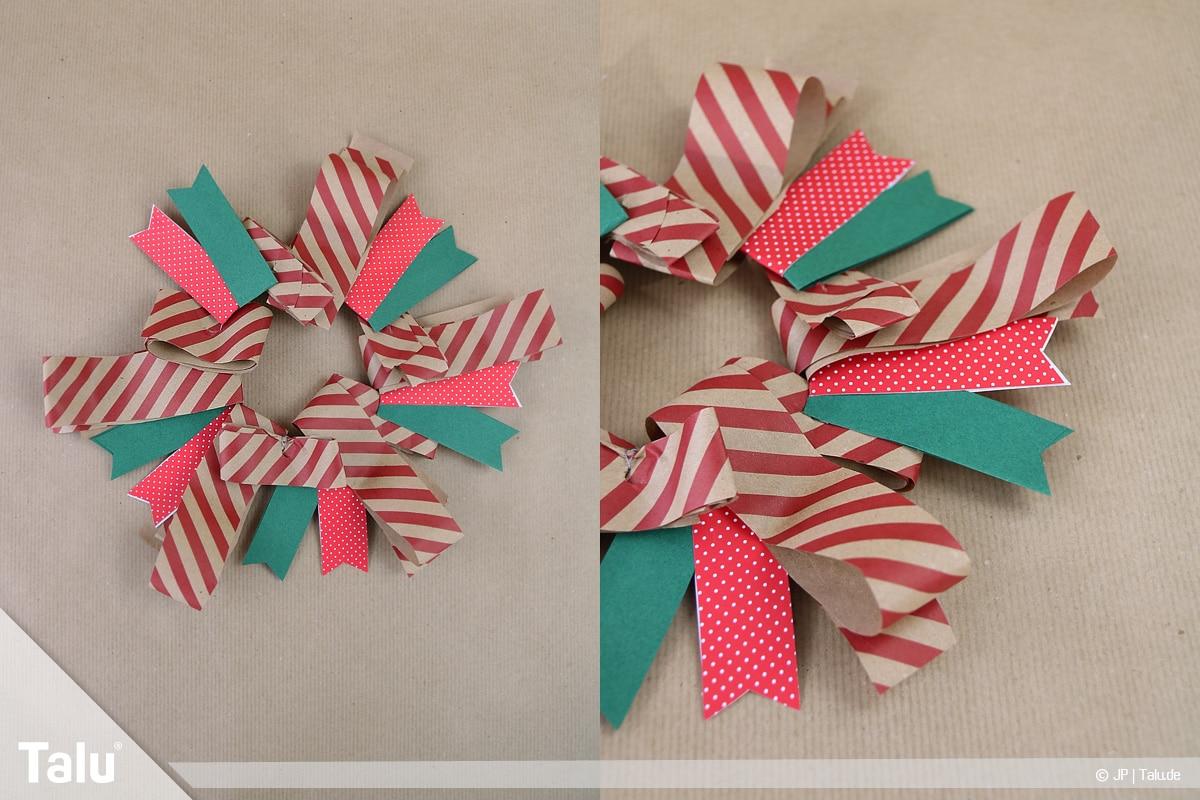 Basteln mit Papier an Weihnachten, Ideen, fertig gebastelter Adventskranz aus Papierstreifen