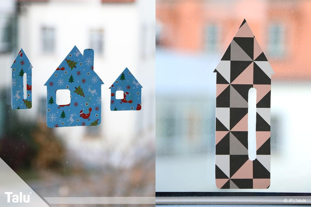 Basteln mit Papier an Weihnachten, Ideen, fertige Häuser-Fensterdeko